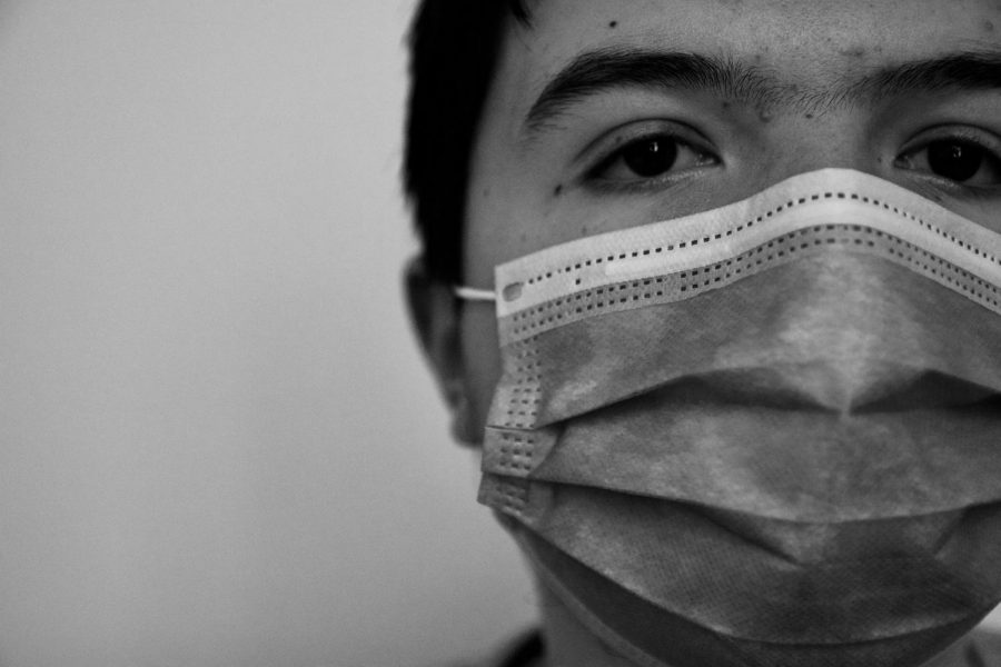 A young man wears a mask during the coronavirus pandemic. Research has shown that masks can be effective in helping prevent the spread of infection.