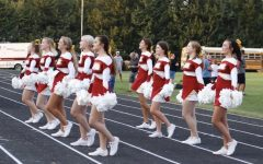 Cheerleaders pump up the crowd at a Friday night football game!