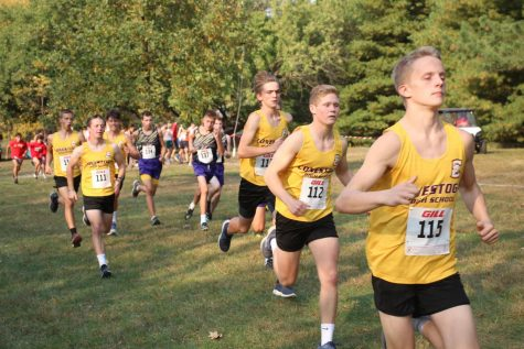 The boys cross country team warms up before racing at the Nebraska Capitol Conference meet on Thursday, Oct. 8.