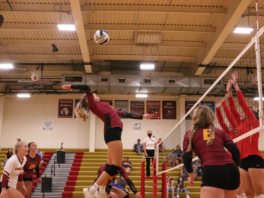 Taylor McClatchey gets way up to drive home a kill against JCC.