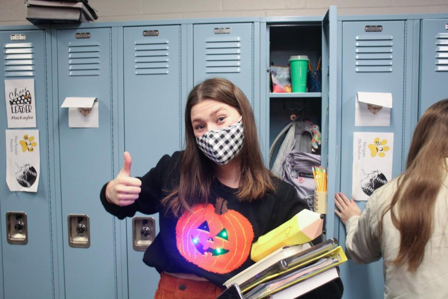 Junior Addison Anderson's Halloween spirit is on full display as she navigates the CHS hallways on Friday, Oct. 30. Students were allowed to wear school appropriate Halloween costumes on All Hallows' Eve.