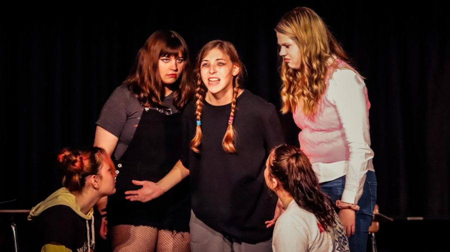 Playing the role of Jennifer Scott, Jasmine Rainey (center) is surrounded by fellow castmates in Conestoga High School's one-act performance of 'No Problem'. The performance is directed by Jessica Schlichtemeier with assistance from Helen Zahn.