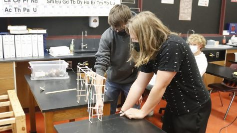 Juniors Jake Heronimus and Gabe Turner-Hickey examine the bridge they created in Mr. Huskey