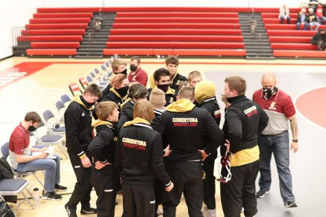 The Conestoga wrestling team gets some last minute instructions from the coaching staff prior to taking the mat against Treynor. The Cougars dropped the dual 54-27 to the Cardinals.