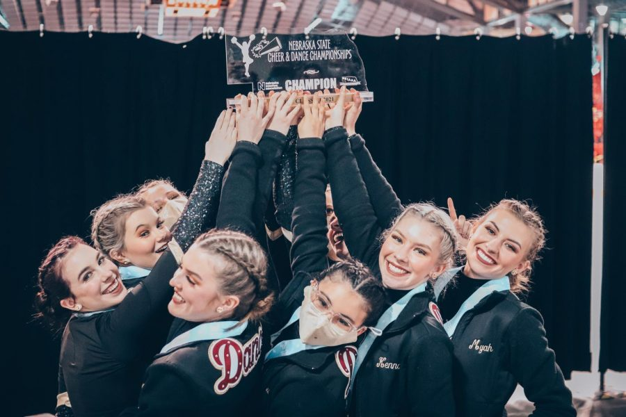 The Conestoga dance team poses with their state championship hip-hop trophy. This is the team's fifth championship in the past four years.