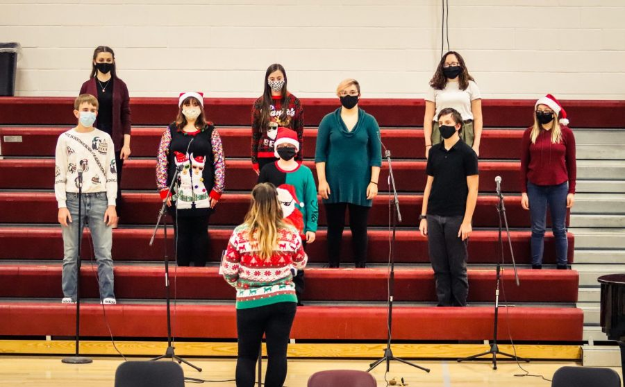 The high school choir performs in masks during a December 2020 concert. The COVID-19 pandemic has brought forth many changes in the way events and contests are held.