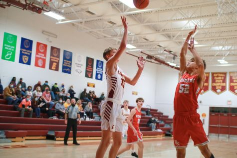 Lucas Michel drives to the rim in a contest against Bishop Neumann. The Cougars dropped the contest 71-55.