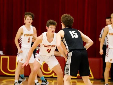 Sophomore guard Jack Welch (4) mans up against Noah Arent (15) during Conestoga