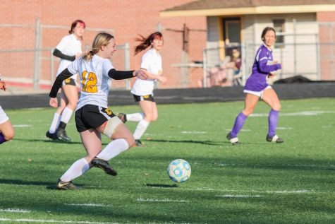 Mati Steckler (Jr.) cheerfully navigates her way through the Nebraska City defense in an April 1 contest against the Pioneers.