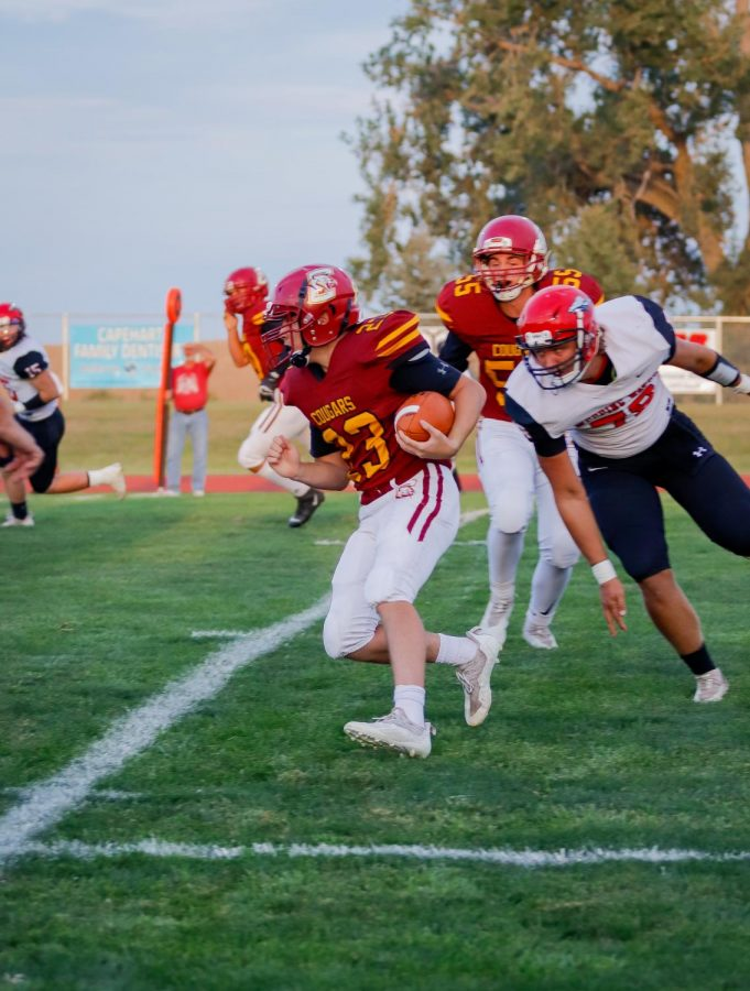 Keaghon Chini avoids a Weeping Water defender in the homecoming game.