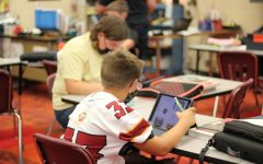 Eighth-grade students working in history class