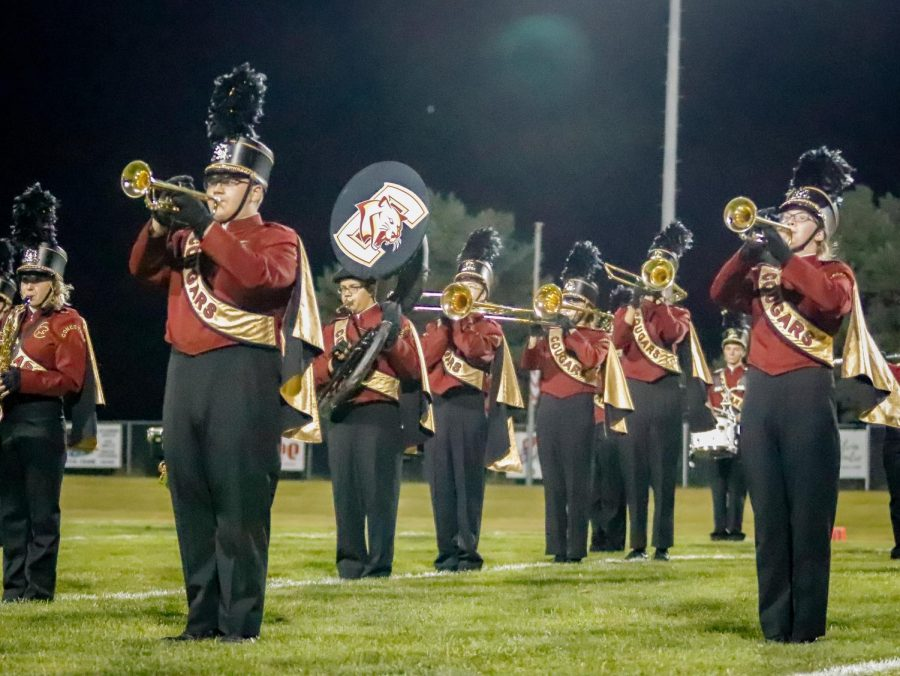 The Conestoga marching band plays their field show at a home football game.